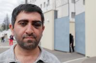 Armenian citizen Vartan Grigoryan poses for a picture outside a detention centre in Minsk
