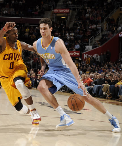 CLEVELAND, OH - FEBRUARY 9: Danilo Gallinari #8 of the Denver Nuggets drives to the basket against C.J. Miles #0 of the Cleveland Cavaliers at The Quicken Loans Arena on February 9, 2013 in Cleveland, Ohio. (Photo by David Liam Kyle/NBAE via Getty Images)