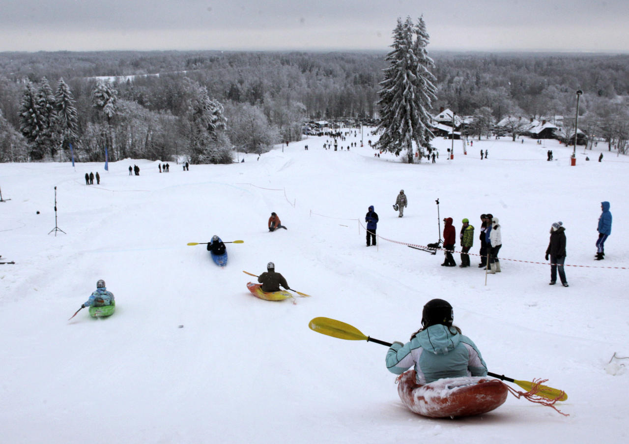People compete during a snow kayak downhill race near Otepaa, January 26, 2013. REUTERS/Ints Kalnins (ESTONIA - Tags: SPORT SOCIETY TPX IMAGES OF THE DAY) - RTR3D036