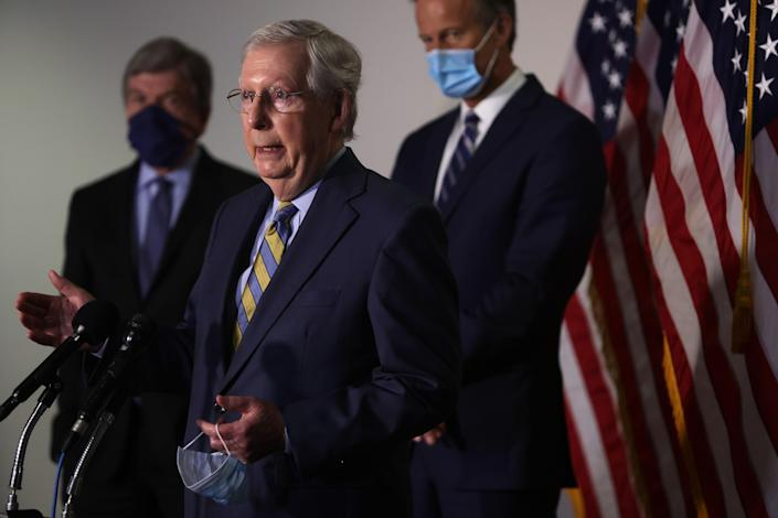 Senate Majority Leader Mitch McConnell speaks to reporters on Capitol Hill on Tuesday. (Alex Wong/Getty Images)