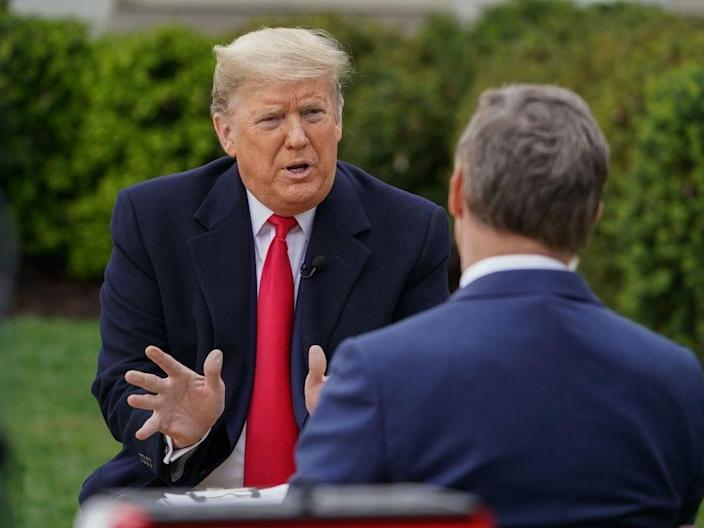 President Donald Trump speaks with Fox News anchor Bill Hemmer for a virtual town hall meeting in the White House Rose Garden on March 24, 2020.