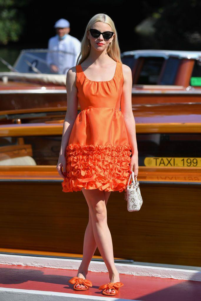 <p>The 25-year-old wore a bright orange 1960s-style mini dress by Dice Kayek to arrive at the film festival. </p>