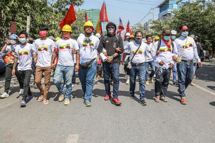 """Protesters from all Burma Federation of Youth unions march ahead of other protesters during the military coup protest in Mandalay on Feb. 24, 2021.<span class=""""copyright"""">Kaung Zaw Hein/SOPA Images/LightRocket via Getty Images</span>"""