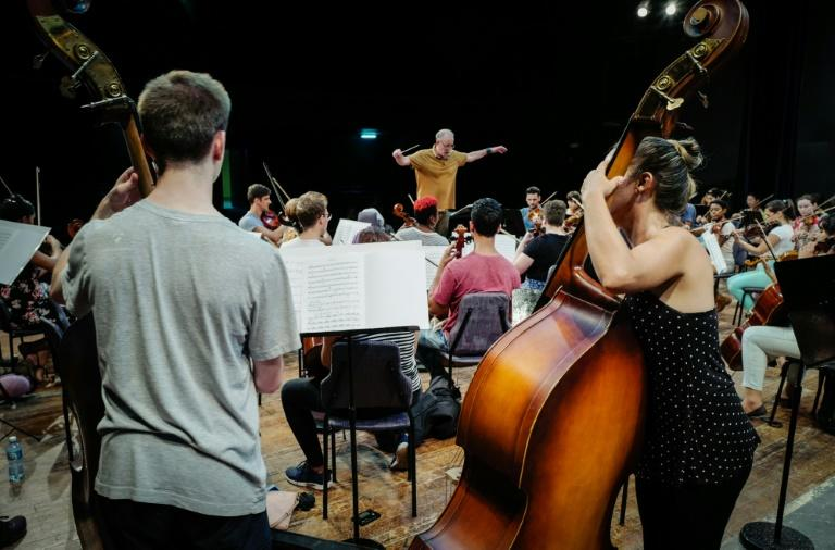 James Ross (C) conducts the Cuban American Youth Orchestra during a rehearsal at Havana's National Theater