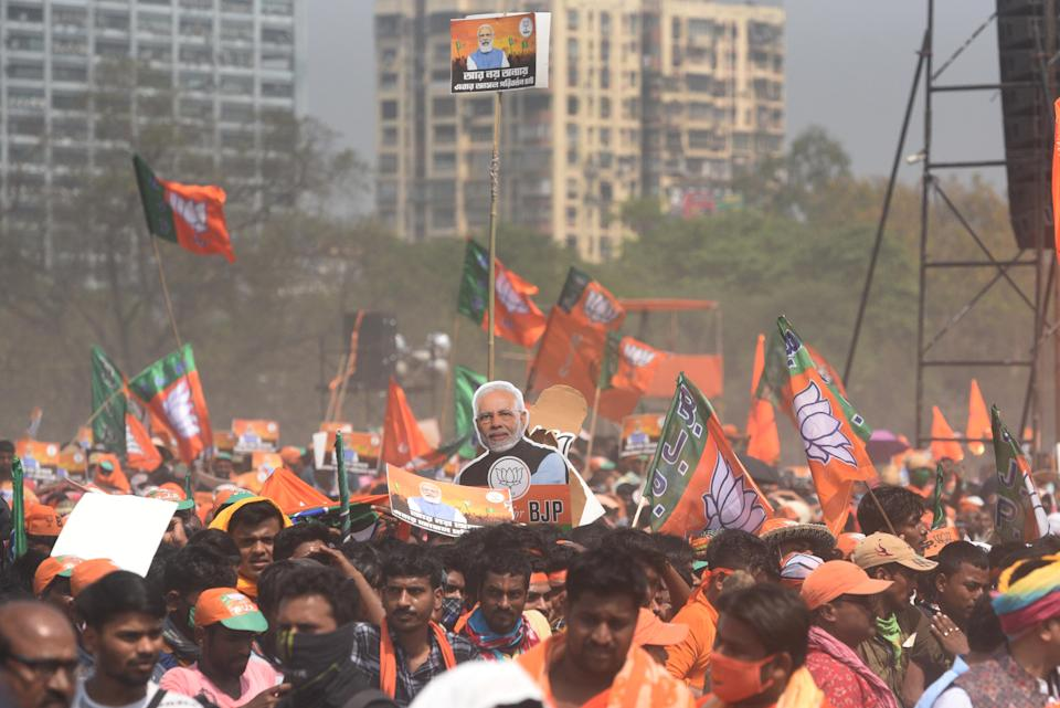 Bharatiya Janata Party (BJP) supporters gathered to listen to Prime Minister Narendra Modi's speech at a public rally being held at Brigade Parade Ground on March 7, 2021 in Kolkata, India. (Photo by Samir Jana/Hindustan Times via Getty Images)