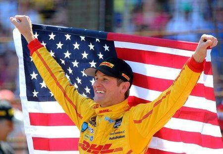 May 25, 2014; Indianapolis, IN, USA; IndyCar Series driver Ryan Hunter-Reay holds an American flag as he celebrates after winning the 2014 Indianapolis 500 at Indianapolis Motor Speedway. Mark J. Rebilas-USA TODAY Sports