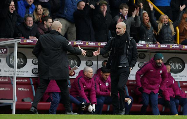 "Soccer Football - Premier League - Burnley vs Manchester City - Turf Moor, Burnley, Britain - February 3, 2018 Burnley manager Sean Dyche shakes hands with Manchester City manager Pep Guardiola at the end of the match REUTERS/Andrew Yates EDITORIAL USE ONLY. No use with unauthorized audio, video, data, fixture lists, club/league logos or ""live"" services. Online in-match use limited to 75 images, no video emulation. No use in betting, games or single club/league/player publications. Please contact your account representative for further details."