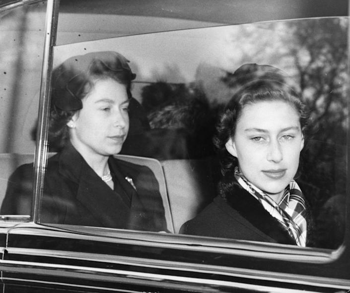 Queen Elizabeth II with Princess Margaret returning to London from Windsor, where the Queen took up residence in Buckingham Palace for the first time since her accession.   (Photo by PA Images via Getty Images)