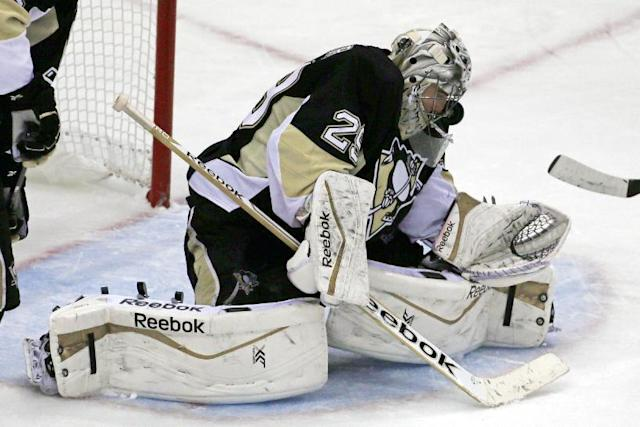 Pittsburgh Penguins goalie Marc-Andre Fleury stops a shot in the third period of a first-round NHL playoff hockey game against the Columbus Blue Jackets in Pittsburgh on Wednesday, April 16, 2014. The Penguins won 4-3. (AP Photo/Gene J. Puskar)