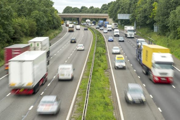 View of a busy M6 Motorway in The Midlands, traffic flowing with motion blur.