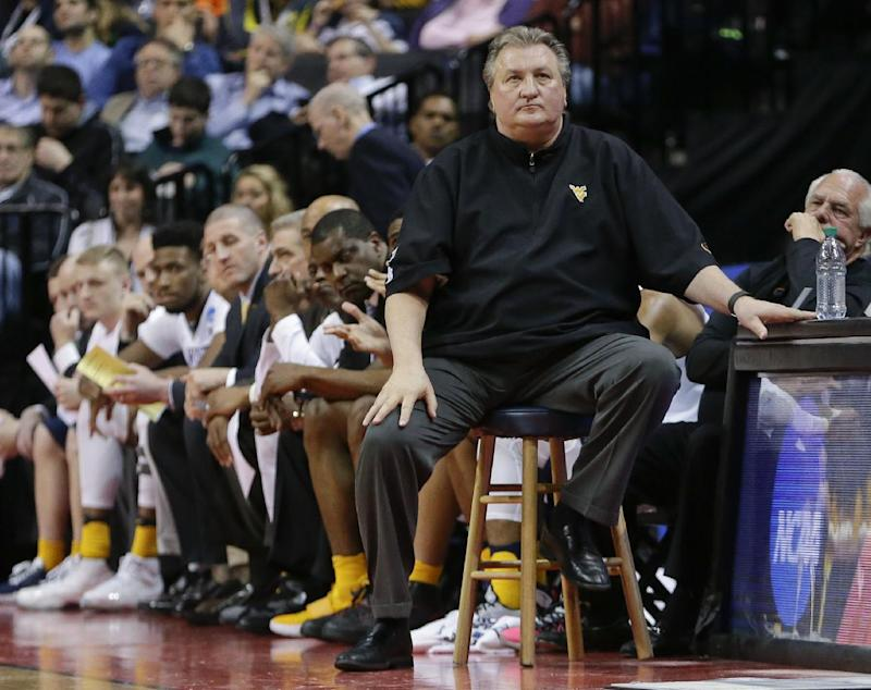 FILE - In this March 18, 2016, file photo, West Virginia head coach Bob Huggins watches his team play during the second half of a first-round men's college basketball game against Stephen F. Austin in the NCAA Tournament in New York. Huggins has found memories  of his last NCAA Tournament visit to Buffalo,  as it launched the Mountaineers' run to the Final Four in 2010. It's last year Huggins would like to forget when the Mountaineers were upset in the first round by Stephen F. Austin. On Thursday, the West Region's fourth-seeded Mountaineers  open against Bucknell in Buffalo. (AP Photo/Frank Franklin II)