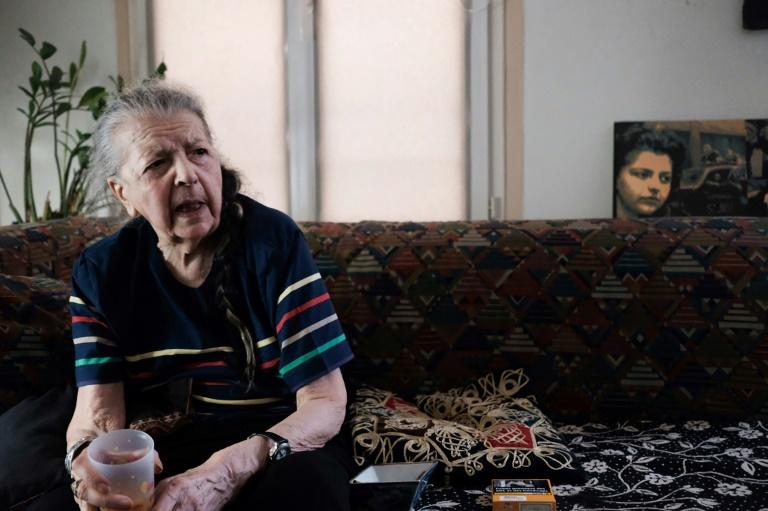 'I expected to be shot': Riffaud in her Paris apartment, with a picture of her as a 19-year-old Resistance fighter in the background (AFP Photo/Natalie HANDEL)