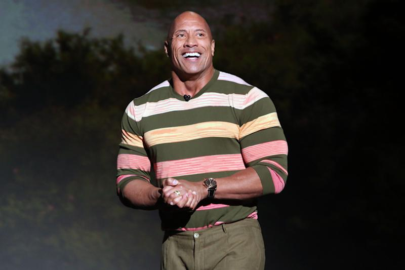 Dwayne Johnson smiling and presenting on stage