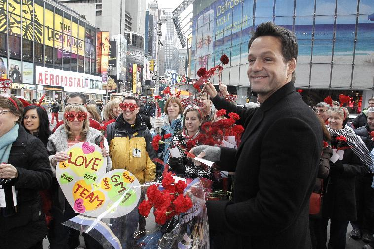 "In this image released by ABC, actor Josh Hopkins, from the comedy series ""Cougar Town,"" hands out carnations on Valentine's Day while appearing on ""Good Morning America,"" Tuesday, Feb. 14, 2012 in New York. The hit comedy series returns for a third season Tuesday at 8:30p.m. EST on ABC. (AP Photo/ABC, Lou Rocco)"