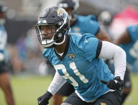FILE PHOTO: Jul 26, 2018; Jacksonville, FL, USA; Jacksonville Jaguars defensive end Yannick Ngakoue (91) runs a protection route during training camp at the Dream Finder Homes practice facility outside of TIAA Bank Field. Reinhold Matay-USA TODAY Sports