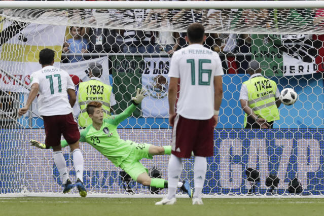Mexico's Carlos Vela, left, kicks to scores his side's opening goal from the penalty spot during the group F match between Mexico and South Korea at the 2018 soccer World Cup in the Rostov Arena in Rostov-on-Don, Russia, Saturday, June 23, 2018. (AP Photo/Lee Jin-man)