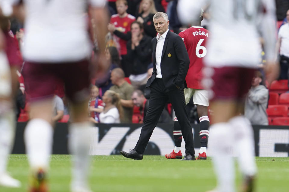 Manchester United's manager Ole Gunnar Solskjaer reacts at the end of the English Premier League soccer match between Manchester United and Aston Villa at the Old Trafford stadium in Manchester, England, Saturday, Sept 25, 2021. (AP Photo/Jon Super)