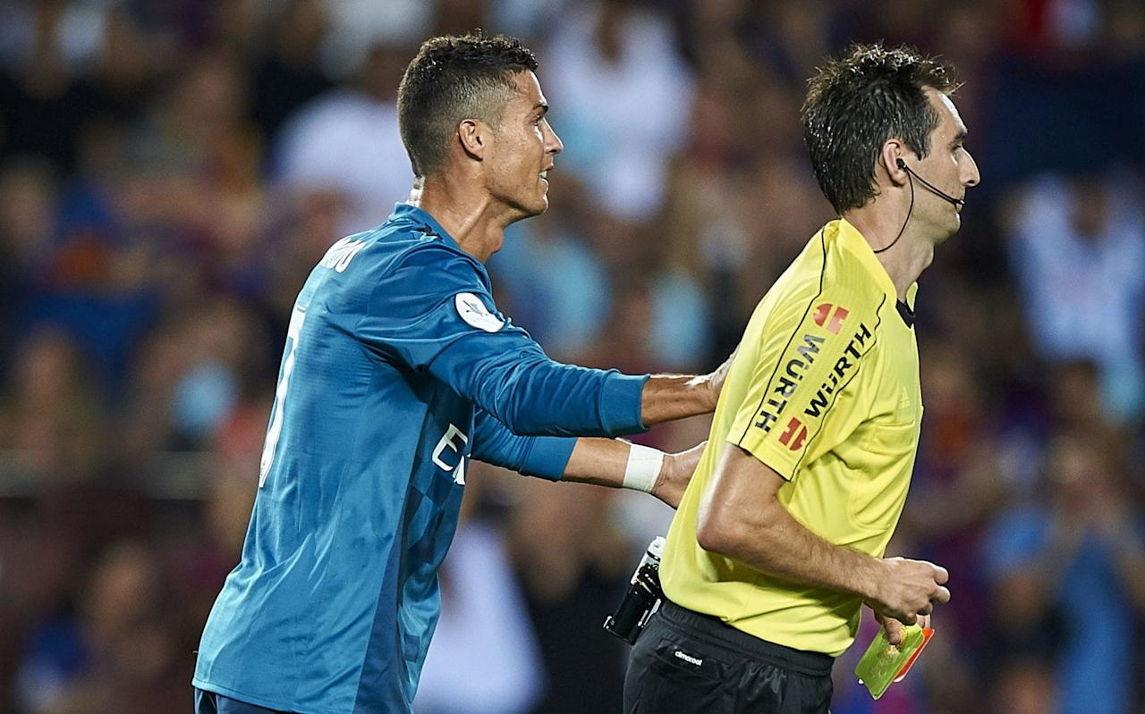 """Cristiano Ronaldo has lashed out at """"one more incomprehensible decision"""" amid reports his five-match ban for shoving a referee was upheld by the Spanish Disciplinary Committee for Sports (TED). Ronaldo had already seen an appeal to the Spanish football federation (RFEF) rejected as he looks to overturn the sanction he received for his ill-tempered reaction to being sent off in the first leg of the Supercopa de Espana earlier this month. Having missed the return leg against Barcelona and Real Madrid's La Liga opener at Deportivo La Coruna at the weekend, he is now set to be sidelined for the Valencia, Levante and Real Sociedad matches. And, following another seemingly unsuccessful appeal, Ronaldo took to Twitter to express his dismay. He wrote: """"One more incomprehensible decision. Injustices that will never bring me down. And as always I will come back stronger. Thank you to those who have supported me."""" Ronaldo remonstrates with the referee Credit: AFP Ronaldo was found guilty of 'Violation of article 96 of the Disciplinary Code', which relates to using """"mild force"""" against the officials, including grabbing, pushing or shaking. The incident occurred in the closing stages at the Nou Camp, where Ronaldo had come off the bench to put Real ahead before being given his marching orders after collecting two yellow cards in quick succession. The second caution was given for an apparent dive in the Barcelona area, and Ronaldo reacted with disbelief before pushing match official Ricardo de Burgos Bengoetxea in the back. He was also fined £3,459, with Real fined £1,590."""
