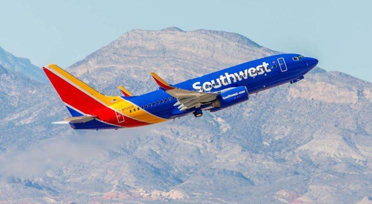 Southwest (LUV) plane mid-flight with mountains in background
