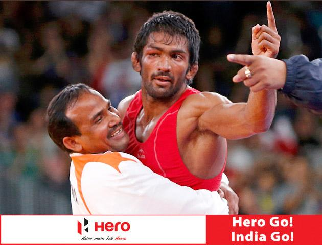 India's Yogeshwar Dutt (in red) reacts after defaeting for the bronze medal North Korea's Jong Myong Ri on the Men's 60Kg Freestyle wrestling at the ExCel venue during the London 2012 Olympic Games August 11, 2012.             REUTERS/Suhaib Salem