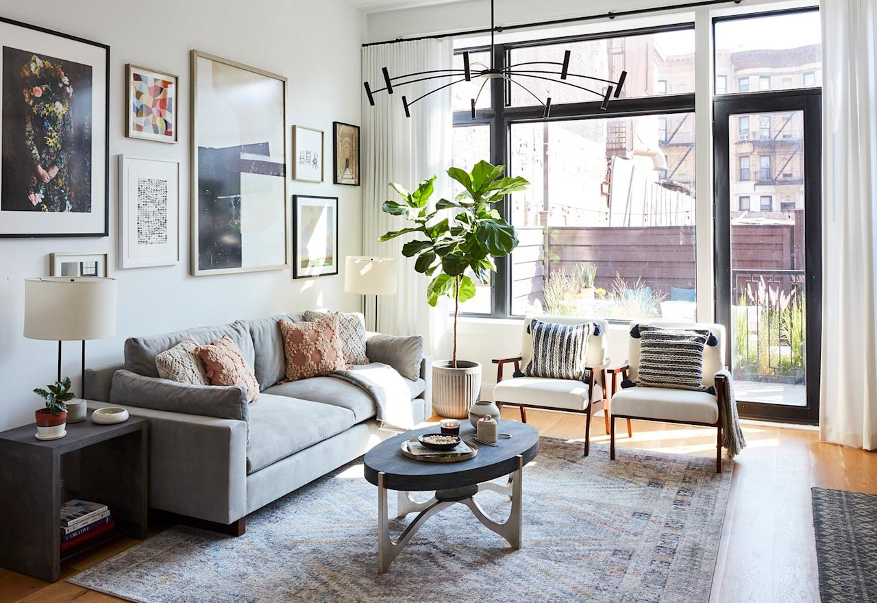 "<p><strong>Designer: <a href=""https://www.realsimple.com/home-organizing/decorating/real-simple-home-gallery-wall"" target=""_blank"">Anita Yokota Interior Design</a></strong></p> <p>When combined with white walls and plenty of natural light, dark furniture doesn't feel heavy or overbearing. Organic pottery, interesting textiles, and raw wood elements soften the sleek lines of the furniture and frames.</p> <p><strong>Rule of Thumb</strong><br /> The center point of a gallery wall should be about 60 inches high. Generally, the width of the collection should not extend past your end tables.</p>"