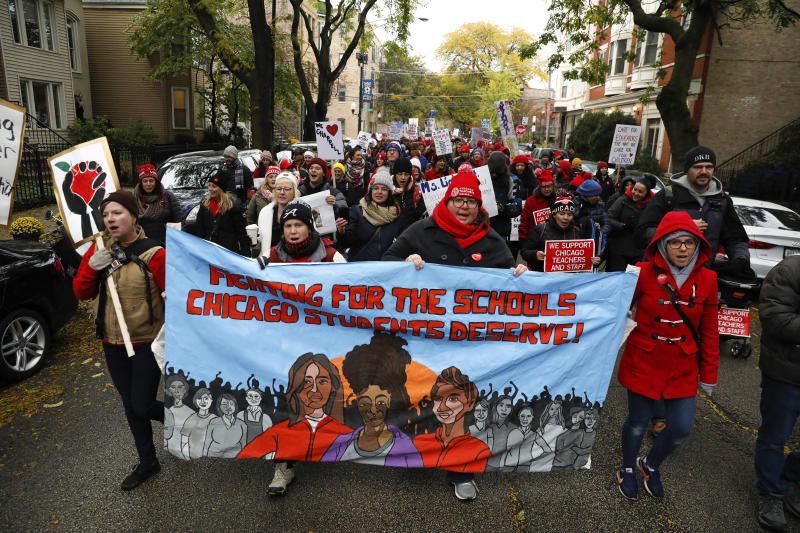 "Chicago Teachers Union members march to the Lincoln Yards development in Chicago, Tuesday, Oct. 29, 2019. Representatives for striking Chicago teachers expressed hope following late-night bargaining talks and says the Chicago Teachers Union ""has laid out a path for a settlement"" that could reopen classrooms in the nation's third-largest school district. (Jose M. Osorio/Chicago Tribune via AP)"