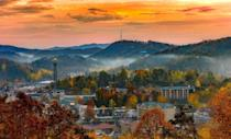 """<p>A hidden gem among the Smoky Mountains, <a href=""""https://www.gatlinburg.com/"""" rel=""""nofollow noopener"""" target=""""_blank"""" data-ylk=""""slk:Gatlinburg, Tennessee"""" class=""""link rapid-noclick-resp"""">Gatlinburg, Tennessee</a> started as one of the greatest independent arts communities stemming from European settlers in the early 1800s. There are over 100 local artists along an eight-mile path called the Gatlinburg Arts & Crafts Community that includes pottery, <a href=""""https://www.elledecor.com/life-culture/a36028991/chanel-escale-venise/"""" rel=""""nofollow noopener"""" target=""""_blank"""" data-ylk=""""slk:jewelry"""" class=""""link rapid-noclick-resp"""">jewelry</a>, and handmade wooden sculptures. The art found here truly represents the charm of this Southern town that makes each visit a new adventure. </p>"""