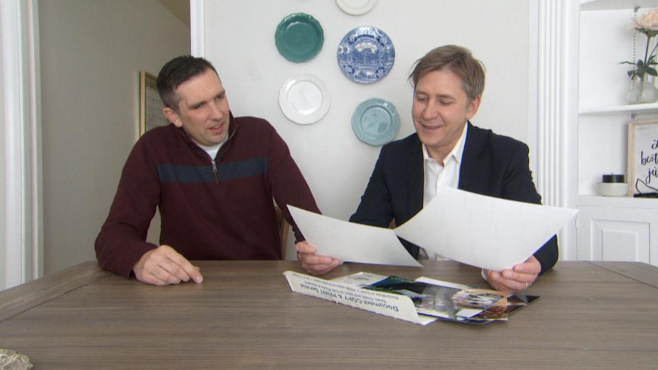 Ben Taylor shows Steve Hartman the original photos that Joel took for him. (Photo: CBS Evening News)