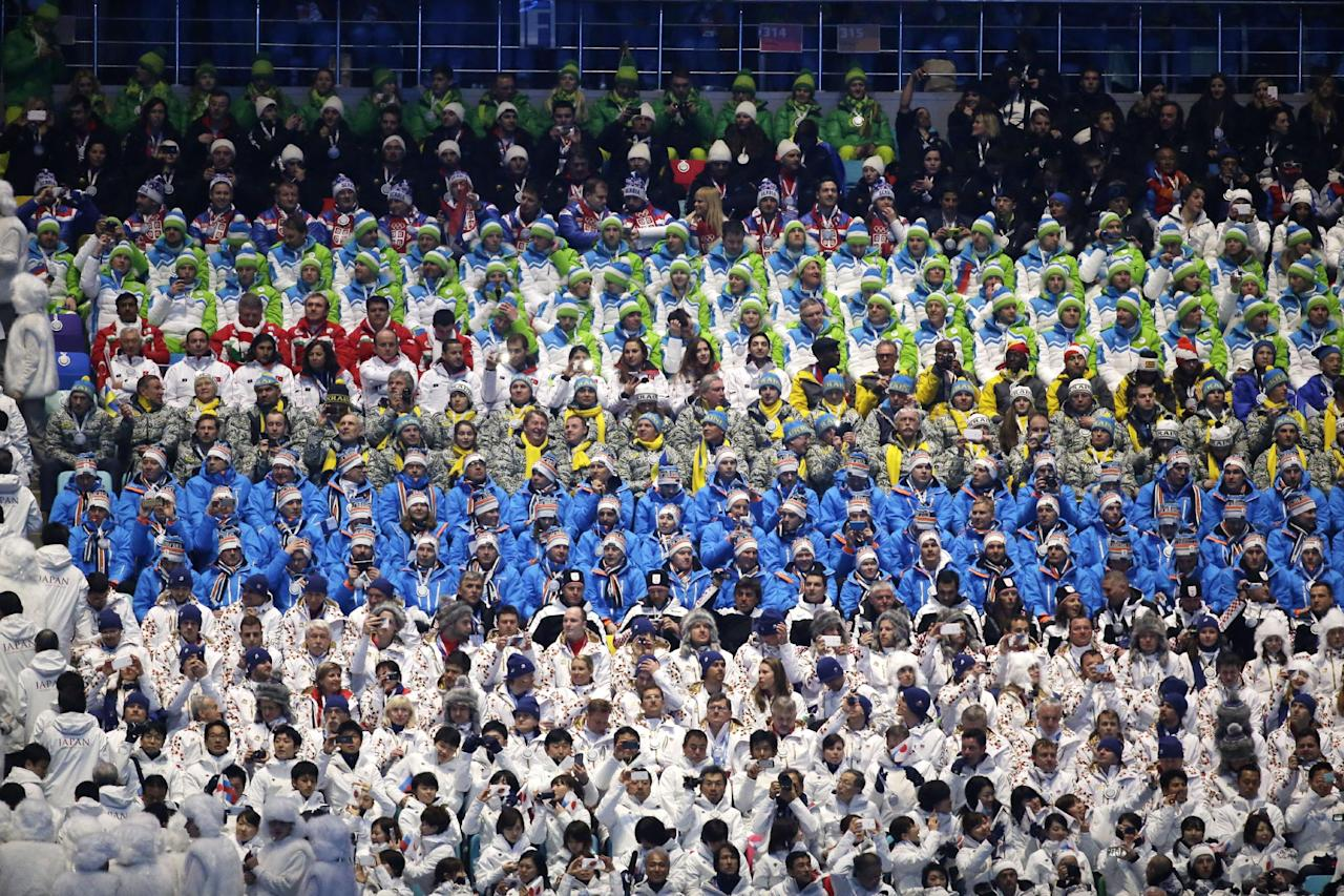 Athletes watch the opening ceremony of the 2014 Winter Olympics in Sochi, Russia, Friday, Feb. 7, 2014. (AP Photo/Mark Humphrey)
