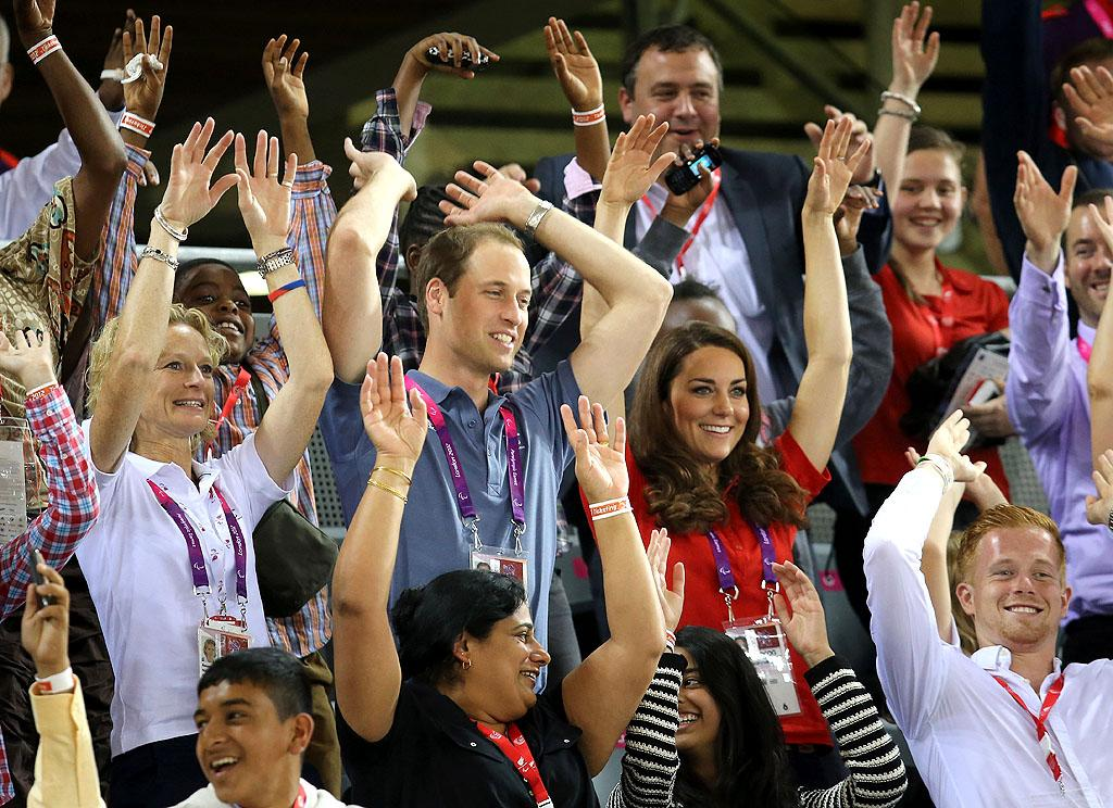 The royal family has plenty of traditions, so why wouldn't they want to take part in a famous one that pro sports spectators around the world honor -- the wave! Prince William and wife Kate Middleton got into the spirit with fellow fans when they cheered on some track cyclers during the first day of the Paralympic Games in London on Thursday. (8/30/2012)