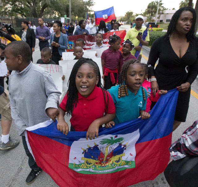 <p>Haitian-Americans march to commemorate the eighth anniversary of the Haitian earthquake, Friday, Jan. 12, 2018, in Miami, Fla. (Photo: Wilfredo Lee/AP) </p>