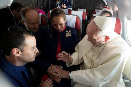 Pope Francis celebrates the marriage of crew members Paula Podest and Carlos Ciufffardi during the flight between Santiago and the northern city of Iquique