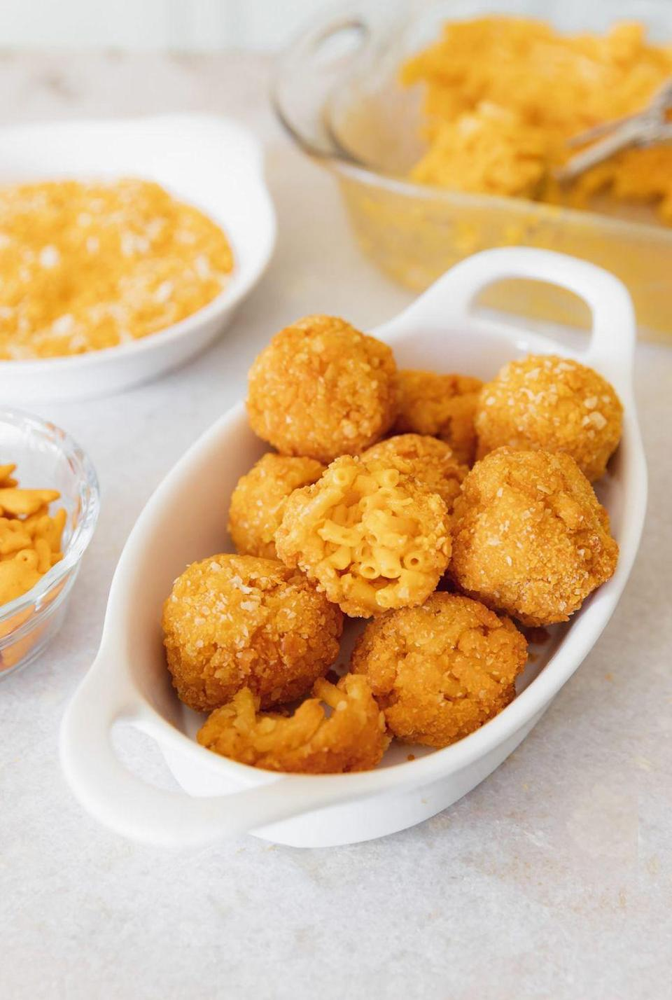 """<p>Fried mac and cheese bites are a fun appetizer, and they're super easy to make when you start with a boxed mix. The coating in this version is crushed cheese crackers. Yum!</p><p><strong>Get the recipe at <a href=""""https://www.texaztaste.com/annies-macaroni-and-cheese-arancini-recipe/"""" rel=""""nofollow noopener"""" target=""""_blank"""" data-ylk=""""slk:TEXAZ TASTE"""" class=""""link rapid-noclick-resp"""">TEXAZ TASTE</a>. </strong></p>"""