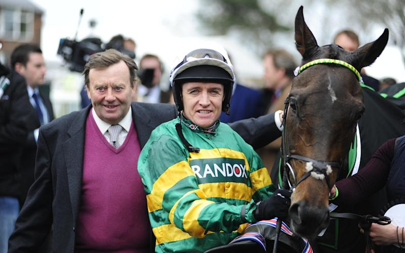 Jockey Barry Geraghty with trainer Nicky Henderson after Buveur D'Air won the Aintree Hurdle - Credit: Rex