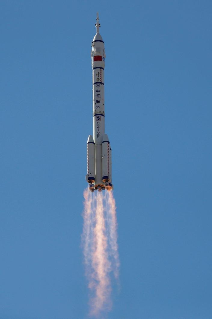 long march 25 rocket launch against blue sky shenzhou-12 chinese space station missions