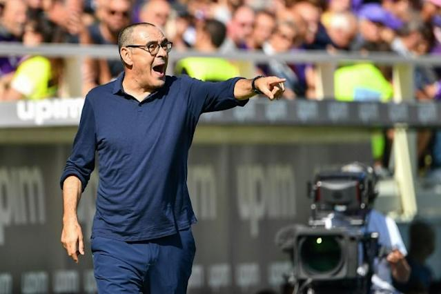 Maurizio Sarri made his debut on the bench for Juventus in Florence after recovering from pneumonia. (AFP Photo/Vincenzo PINTO )