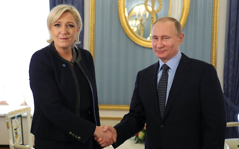 Vladimir Putin and Marine Le Pen met in the Kremlin on March 24 - Credit: Sputnik/Reuters