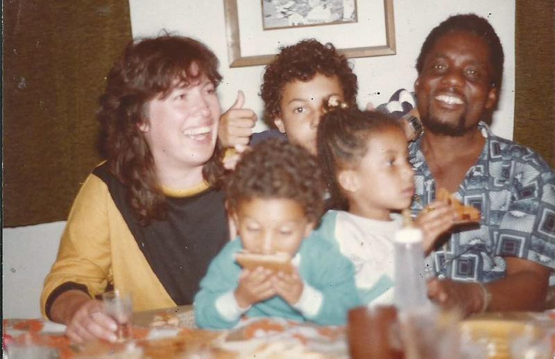 My mother, father, and me with my two brothers, Anaelechi and Chike.