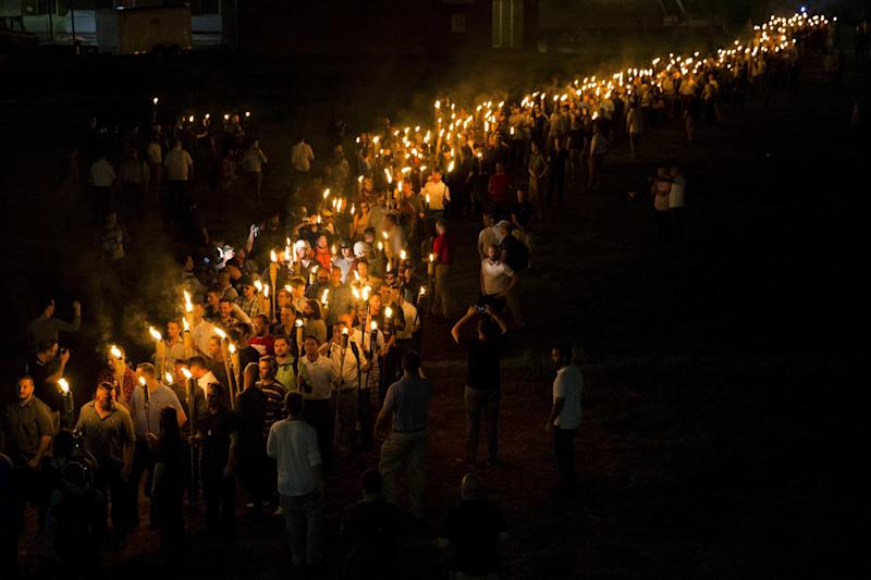 <strong>White supremacists march through the University of Virginia Campus</strong> (Anadolu Agency via Getty Images)