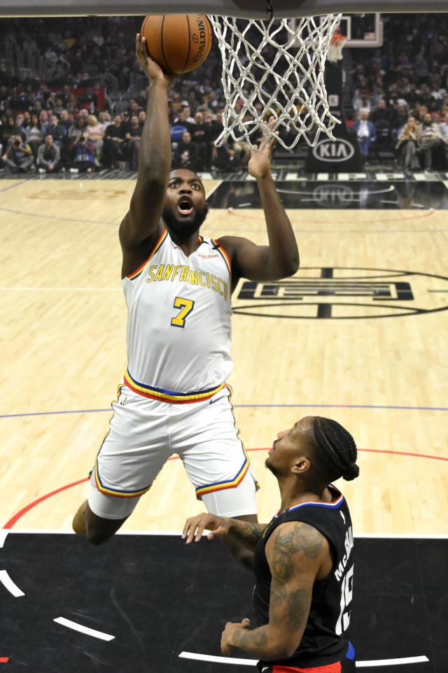Golden State Warriors forward Eric Paschall shoots as Los Angeles Clippers guard Rodney McGruder defends during the first half of an NBA basketball game Friday, Jan. 10, 2020, in Los Angeles. (AP Photo/Mark J. Terrill)