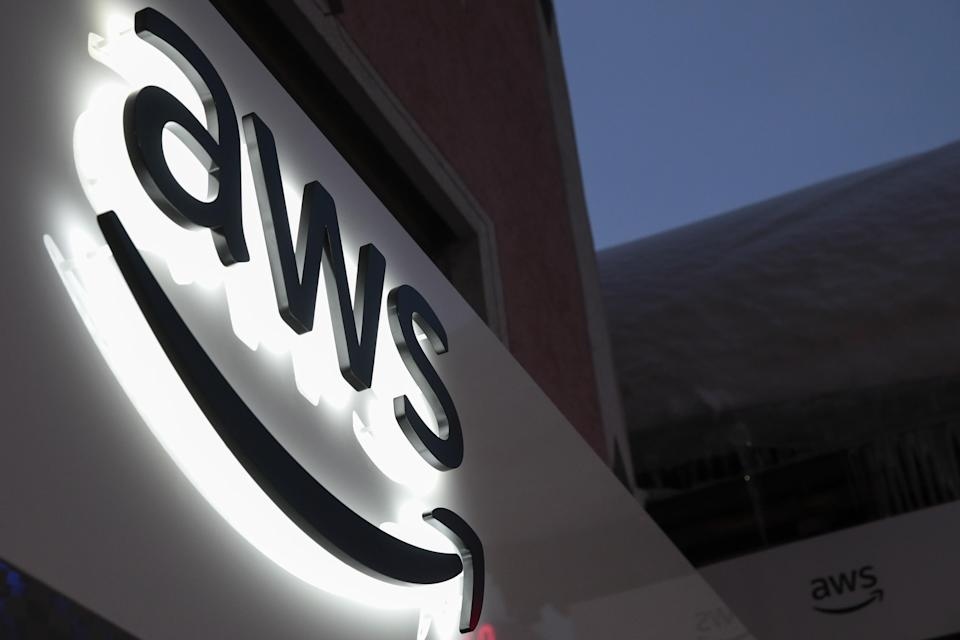 The logo of Amazon Web Services Inc (AWS) is displayed on a sign at a pop-up office ahead of the World Economic Forum (WEF) in Davos, Switzerland, on Monday, Jan. 21, 2019. World leaders, influential executives, bankers and policy makers attend the 49th annual meeting of the World Economic Forum in Davos from Jan. 22 - 25. Photographer: Jason Alden/Bloomberg via Getty Images