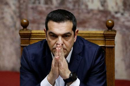 FILE PHOTO: Greek PM Tsipras looks on during a parliamentary session before a confidence vote in Athens