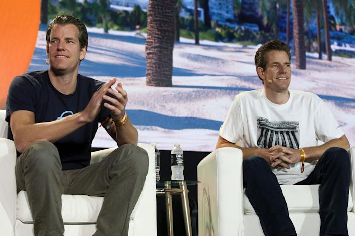 Tyler Winklevoss (L) and Cameron Winklevoss, founders of crypto exchange Gemini Trust Co., attend the crypto-currency conference Bitcoin 2021 Convention at the Mana Convention Center in Miami, Florida, on June 4, 2021. (Photo by Marco BELLO / AFP) (Photo by MARCO BELLO/AFP via Getty Images)