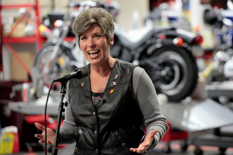 Republican Senator Joni Ernst speaks to reporters at Big Barn Harley-Davidson before the 3rd Annual Roast and Ride in Des Moines, Iowa, on June 3, 2017.