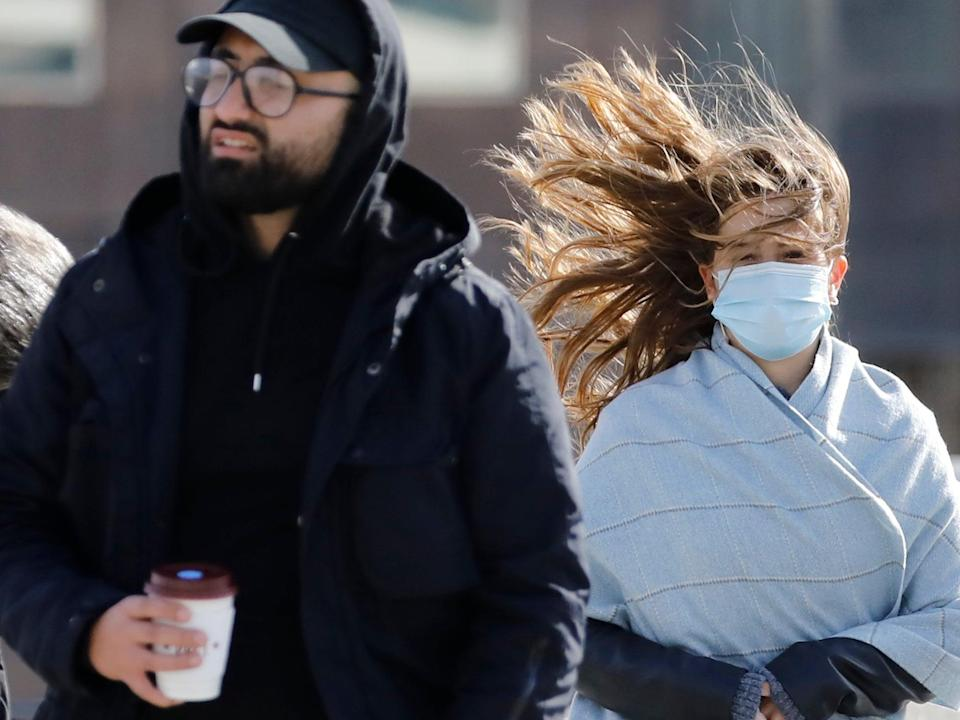 Pedestrians face windy conditions as they cross London Bridge in central London over the weekend (AFP via Getty Images)