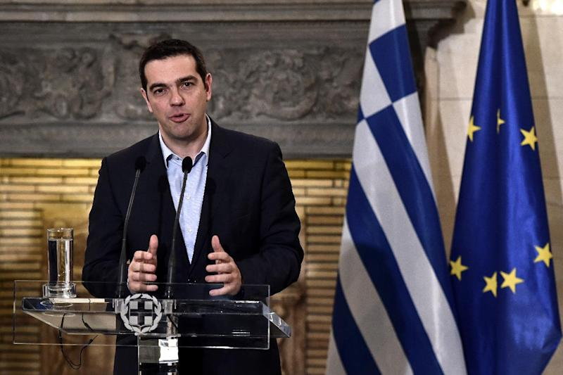 Greek Prime Minister Alexis Tsipras gives a press conference after his meeting with the head of the Organization for Economic Co-operation and Development, in Athens, on February 11, 2015