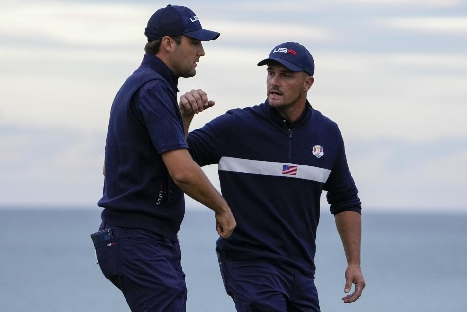 Team USA's Bryson DeChambeau and Team USA's Scottie Scheffler during a four-ball match the Ryder Cup at the Whistling Straits Golf Course Saturday, Sept. 25, 2021, in Sheboygan, Wis. (AP Photo/Jeff Roberson)