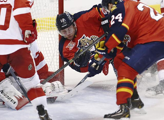 Florida Panthers' Jesse Winchester (17) tries a shot-on-goal against Detroit Red Wings goalie Jmmy Howard during the first period of a NHL hockey game in Sunrise, Fla., Tuesday, Dec. 10, 2013. (AP Photo/J Pat Carter)