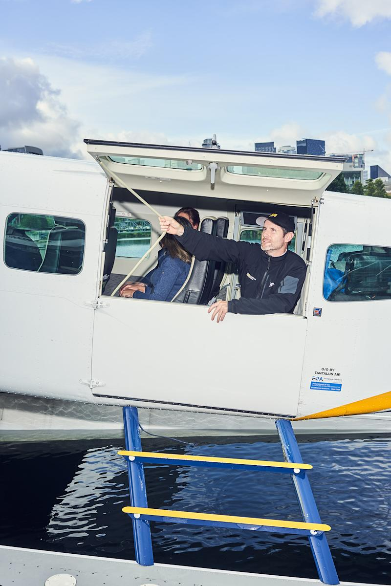 A Harbour Air crew member prepares for take-off on a seaplane flying from Seattle to Vancouver on July 11. When the Vancouver-Seattle route launched last year, tech companies bought tickets in bulk so their employees could go back and forth between Canada and the United States easily. | Ian Allen for TIME