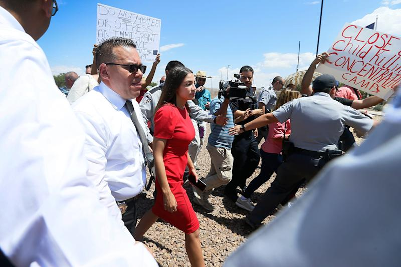 U.S. Rep Alexandria Ocasio-Cortez, D-New York, is escorted back to her vehicle after she speaks at the Border Patrol station in Clint about what she saw at area border facilities Monday, July 1, at the station in Clint.